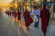 Monks receiving food at Taung Gyi Village in Myanma