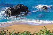 Afternoon light on rocks and surf at Lumaha'i Beach, North Shore, Island of Kauai, Hawaii