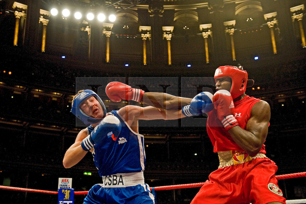 © Licensed to London News Pictures. London, UK  07/10/2011. JACK JONES, Royal Navy (left) Vs DARNELL PRICE II, US Marine Corp (Right). Members of the UK and US Armed Forces take part in the Royal Albert Hall cup boxing match. This is the first time a boxing event has taken place in the historic venue following a court ruling banning the use of the hall for boxing and wrestling in 1999. The Court of Appeal subsequently overturned the decision earlier this year. The venue has hosted some of the greatest names in British boxing including Sir Henry Cooper, Frank Bruno, Lennox Lewis and Prince Naseem Hamed. Photo credit: Ben Cawthra/LNP