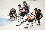 RIT Senior Captain Lindsay Grigg, center, and RIT's Kolbee McCrea try to get a puck past Union's Shenae Lundberg during a game at the Gene Polisseni Center on October 3, 2014.