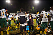 "BIRMINGHAM, AL – SEPTEMBER 11, 2015: Sonya Whitaker (center) returns from speaking with Quintarius Monroe on the sidelines of a high school football game. ""I'm here to make sure he doesn't get in trouble,"" Whitaker said. As a type 1 diabetic, Quintarius Monroe requires frequent blood sugar testing and supervision when self-administering insulin. When care from qualified personnel at his school in Center Point became unavailable, Monroe was forced to transfer several miles away from his locally zoned school to attend Woodlawn High School. The Americans with Disabilities Act requires schools to provide ""reasonable accommodation"" for students with medical conditions, but given that most schools no longer retain school nurses, many schools are failing to provide adequate care for their students.<br />