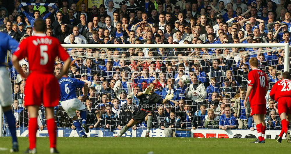 LIVERPOOL, ENGLAND - Saturday, April 19, 2003: Everton's David Unsworth fires in a penalty against Liverpool's Jerzy Dudek during the Merseyside Derby Premiership match at Goodison Park. (Pic by David Rawcliffe/Propaganda)
