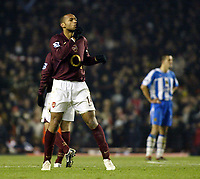 Photo: Chris Ratcliffe.<br />Arsenal v Wigan Athletic. Carling Cup. 24/01/2006.<br />Thierry Henry tells the Wigan fans to be quiet after scoring