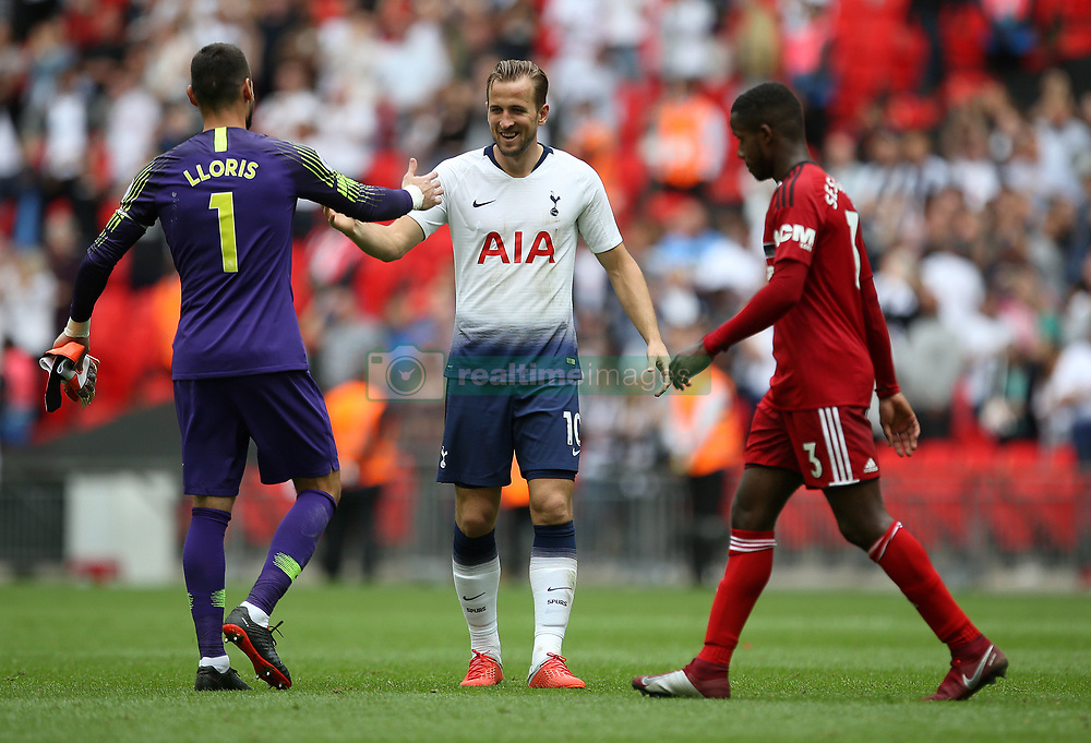 Tottenham Hotspur's Harry Kane with Hugo Lloris after Fulham's Ryan Sessegnon walks past at full time