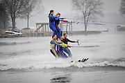 Sherrills Ford, NC - The Carolina Show Ski Team opened the 33rd Annual Lake Norman New Years Day Barefoot Challenge with a 3 level pyramid loop, drawing huge applause from a crowd of about 150 that gathered for the show.  photo © Laura Mueller - www.lauramuellerphotography.com