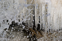 Water splashing on icicles and rocks