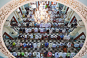 "Sept. 25, 2009 -- PATTANI, THAILAND: Men gather for Friday prayers in the Central Mosque in Pattani, Thailand. The mosque's Imam said a special prayer on this day for the Thai King who is in a hospital in Bangkok. Pattani's Central Mosque is considered the most architecturally striking mosque in Thailand and was a leading tourist site until the current violence put an end to mass tourism in Pattani. Thailand's three southern most provinces; Yala, Pattani and Narathiwat are often called ""restive"" and a decades long Muslim insurgency has gained traction recently. Nearly 4,000 people have been killed since 2004. The three southern provinces are under emergency control and there are more than 60,000 Thai military, police and paramilitary militia forces trying to keep the peace battling insurgents who favor car bombs and assassination.  Photo by Jack Kurtz / ZUMA Press"