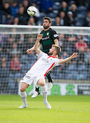 Raith Rovers Laurie Ellis over Falkirk's Rory Loy.<br /> half time : Raith Rovers 0 v 0 Falkirk, Scottish Championship game played 27/9/2014 at Raith Rovers Stark Park.