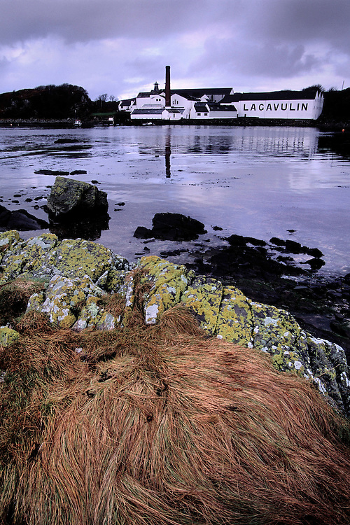 Lagavulin Distillery sits on the bay on the Isle of Islay, Scotland.