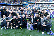 Chelsea FC training team celebrate with the trophy during the Premier League match between Chelsea and Sunderland at Stamford Bridge, London, England on 21 May 2017. Photo by Andy Walter.