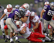 Nebraska defenders Stewart Bradley (34) Jay Moore (44) and Corey McKeon (13) wrap up Kansas State running back Leon Patton (14) for a loss in the first half at Bill Snyder Family Stadium in Manhattan, Kansas, October 14, 2006.  The Huskers beat the Wildcats 21-3.<br />