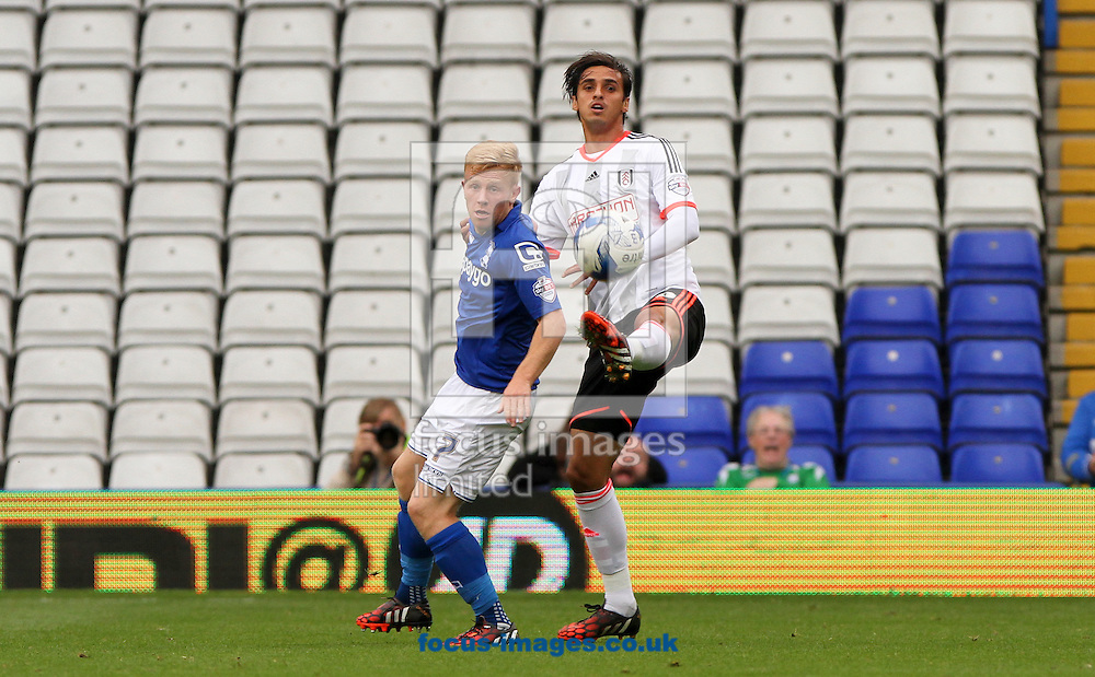 Mark Duffy (left) of Birmingham City and Bryan Ruiz (right) of Fulham battle for the ball during the Sky Bet Championship match at St Andrews, Birmingham<br /> Picture by Tom Smith/Focus Images Ltd 07545141164<br /> 27/09/2014
