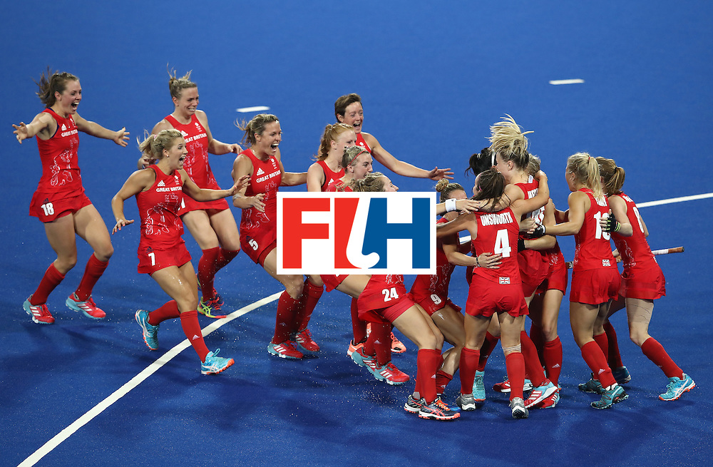 RIO DE JANEIRO, BRAZIL - AUGUST 19:  Great Britain players celebrate winning the shootout against Netherlands to win the Women's Gold Medal Match on Day 14 of the Rio 2016 Olympic Games at the Olympic Hockey Centre on August 19, 2016 in Rio de Janeiro, Brazil.  (Photo by Mark Kolbe/Getty Images)