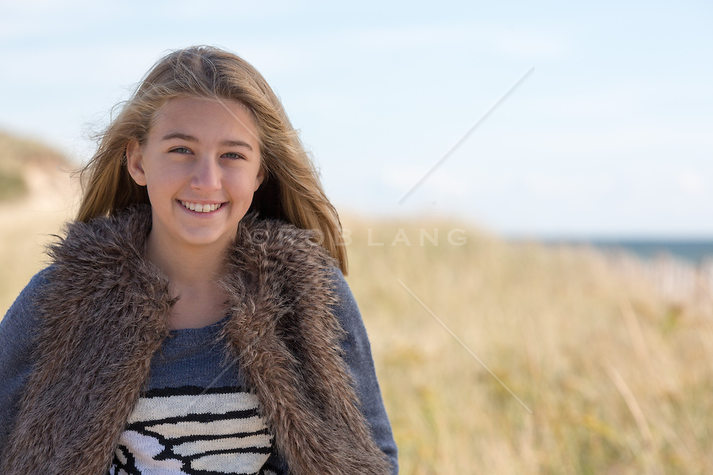teenage girl outdoors on the beach during the Winter