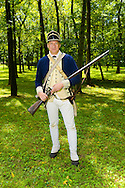 8/18/12 12:28:32 PM - Warwick, PA. -- John Godzieba of Langhorne, Pennsylvania demonstrates the use of a rifle during a revolutionary war reenactment at the Moland House August 18, 2012 in Warwick, Pennsylvania. -- (Photo by William Thomas Cain/Cain Images)