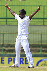 August 12, 2017 - Colombo, Sri Lanka - Sri Lankan cricketer Malinda Pushpakumara  celebrates after taking a wicket   during the 1st Day's play in the 3rd Test match between Sri Lanka and India at the Pallekele International cricket stadium, Kandy, Sri Lanka on Saturday 12 August 2017. (Credit Image: © Tharaka Basnayaka/NurPhoto via ZUMA Press)