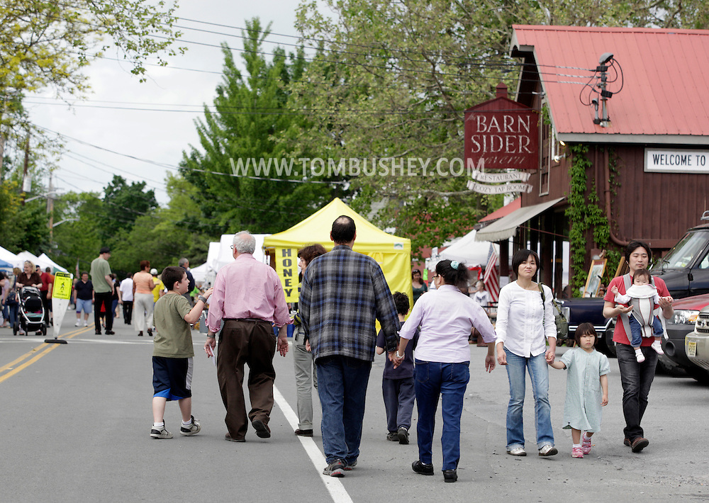 Sugar Loaf, New York - People walk on the closed street during the Sugar Loaf Spring Festival on May 21, 2011.