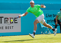 Tennis - 2019 Queen's Club Fever-Tree Championships - Day One, Monday<br /> <br /> Men's Singles, First Round: Cameron Norrie (GBR) Vs. Kevin Anderson (RSA)  <br /> <br /> Kevin Anderson (RSA) stretches to reach the ball on Centre Court.<br />  <br /> COLORSPORT/DANIEL BEARHAM