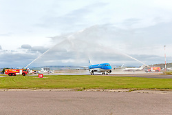 Inverness Airport welcomed KLM's Inaugural flight from Amsterdam. To celebrate the new route, the first flight from Schiphol, Amsterdam was greeted by a water cannon salute upon arrival.  On board were Barry ter Voert, Senior Vice President, Air France KLM European Markets and Wilco Swejen, Director for Aviation Marketing, Schipol Airport.  Provost Helen Carmichael, The Highland Council, Inglis Lyon, Managing Director of Highlands and Islands Aiports and Drew Hendry MP (Inverness, Nairn, Badenoch and Strathspey) met the delegation, officially welcoming the group to the Highlands. <br /> <br /> Pictured: KLM aircraft under water bridge<br /> <br /> Malcolm McCurrach | EEm | Tue, 17, May, 2016