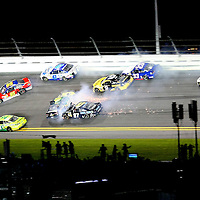 NASCAR Sprint Cup driver Joe Nemechek (87) and Carl Edwards (99)  wreck during the  NASCAR Coke Zero 400 Sprint series auto race at the Daytona International Speedway on Saturday, July 6, 2013 in Daytona Beach, Florida.  (AP Photo/Alex Menendez)