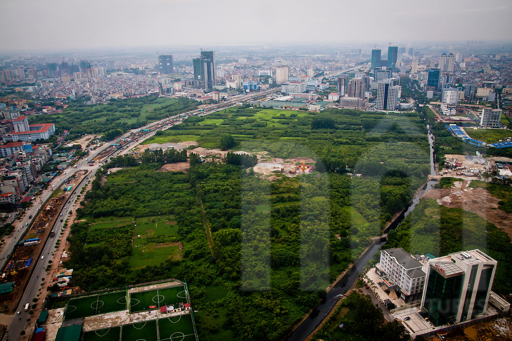 A remaining area of farmland in a developing area of the city, My Dinh, Hanoi, Vietnam
