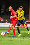 Luke Summerfield shields the ball from Lee Tomlin during the Friendly match between York City and Middlesbrough at Bootham Crescent, York, England on 11 July 2015. Photo by Simon Davies.