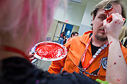 "27 MAY 2011 - PHOENIX, AZ: MIKE J, from Tucson, AZ, gets ""bloodied up"" before participating in the Zombie Walk at Phoenix Comicon Friday. Phoenix Comicon opened Thursday and featured a Zombie Walk through downtown Phoenix Friday night. Hundreds of people participated in the Zombie Walk, both as Zombies and as Zombie hunters. This year's Comicon includes appearances by Leonard Nimoy (Star Trek), Adam Baldwin (Firefly and Chuck), Stan Lee (Marvel Comics), Nicholas Brendon (Buffy the Vampire Slayer) and others. Activities include costuming workshops, role playing games and a Geek Prom.     Photo by Jack Kurtz"