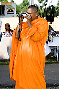 Buddhist monk photographing the days events. Dragon Festival Lake Phalen Park St Paul Minnesota USA
