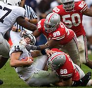 MORNING JOURNAL/DAVID RICHARD.Buckeyes' defenders Jay Richardson, #99, and Joel Penton, #98, sack Penn State quarterback Anthony Morelli yesterday.
