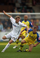 Photo: Rich Eaton.<br /> <br /> Torquay United v Norwich City. Carling Cup. 23/08/2006. Ryan Jarvis (Left) of Norwich City challenges for the ball