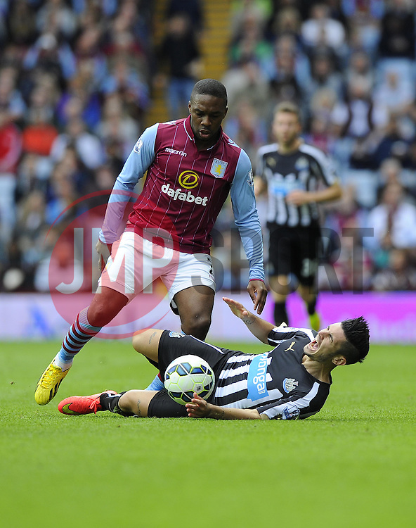 Newcastle United's Remy Cabella is fouled by Aston Villa's Charle N'Zogbia - Photo mandatory by-line: Joe Meredith/JMP - Mobile: 07966 386802 23/08/2014 - SPORT - FOOTBALL - Birmingham - Villa Park - Aston Villa v Newcastle United - Barclays Premier League