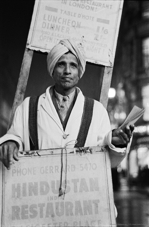 Indian with Sandwich-Board Advertising Hindustani Restaurant, London, 1945