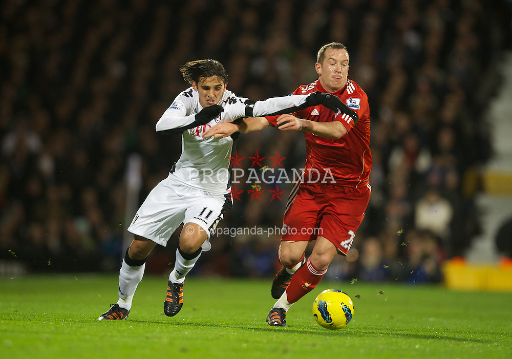 LONDON, ENGLAND - Monday, December 5, 2011: Liverpool's Charlie Adam in action against Fulham's Bryan Ruiz during the Premiership match at Craven Cottage. (Pic by David Rawcliffe/Propaganda)