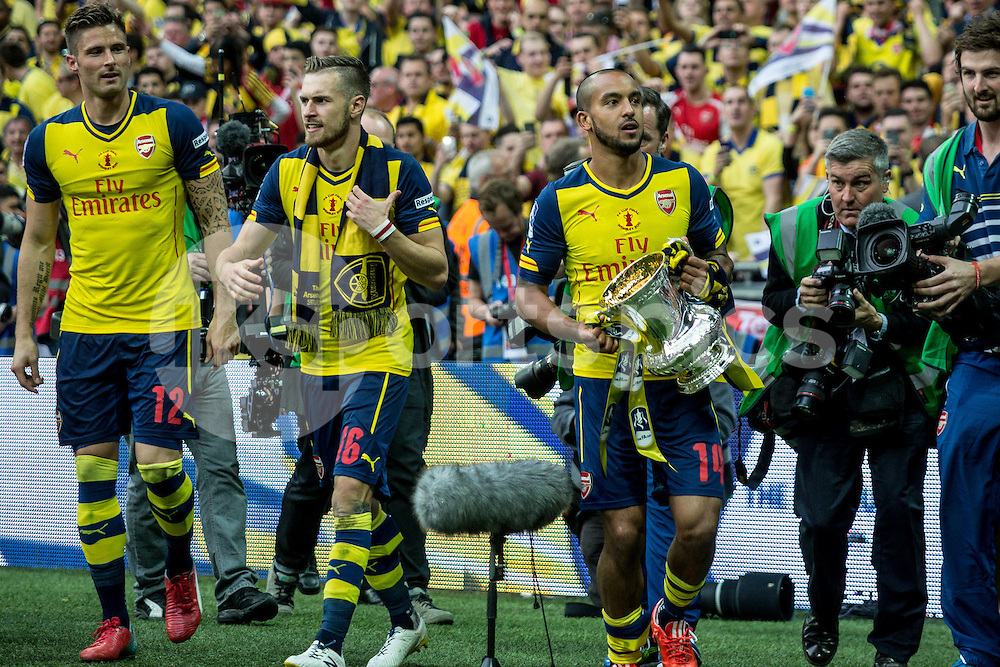 Theo Walcott of Arsenal with the cup after the The FA Cup Final match between Arsenal and Aston Villa at Wembley Stadium, London, England on 30 May 2015. Photo by Liam McAvoy.