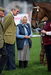 © London News Pictures. 11/05/2016. Windsor, UK. HRH QUEEN ELIZABETH II watches her horse Barber's Shop, win the Thoroughbred Ridden Show Series Qualifier class, on the first day of the 2016 Royal Windsor Horse Show, held in the grounds of Windsor Castle in Berkshire, England. The opening day of the event was cancelled due to heavy rain and waterlogged grounds. This years event is part of HRH Queen Elizabeth II's 90th birthday celebrations.  Photo credit: Ben Cawthra/LNP