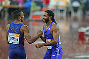 David Omoregie congratulates Jason Richardson of the USA after the 110m hurdles during the Sainsbury's Anniversary Games at the Queen Elizabeth II Olympic Park, London, United Kingdom on 24 July 2015. Photo by Phil Duncan.
