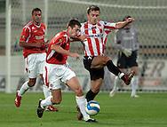 n/z.: Nikola Mijailovic (nr10-Wisla), Piotr Giza (nr7-Cracovia) podczas meczu ligowego Wisla Krakow (czerwone) - Cracovia Krakow (bialo-czerwone) 3:0 ; I liga polska ; 12 kolejka sezon 2006/2007 , pilka nozna , Polska , Krakow , 28-10-2006 , fot.: Adam Nurkiewicz / mediasport..Nikola Mijailovic (nr10-Wisla), Piotr Giza (nr7-Cracovia) during Polish league first division soccer match in Cracow. October 28, 2006 ; Wisla Cracow (red) - Cracovia (white-red) 3:0 ; first division ; 12 round season 2006/2007 , football , Poland , Cracow ( Photo by Adam Nurkiewicz / mediasport )