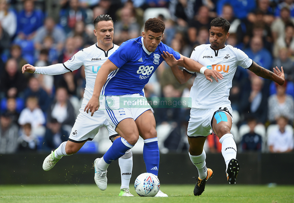 Birmingham City's Che Adams gets away from Swansea City's Roque Mesa (left) and Kyle Naughton (right) during the pre-season match at St Andrews, Birmingham.