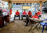 2016/08/04 – Portoviejo, Ecuador: Firemen relax by watching television during their free time in Portoviejo, Ecuador, 4th August 2016. The fireman headquarters collapsed during the 16th April earthquake and they now operate under tents until a new headquarters is build. (Eduardo Leal)