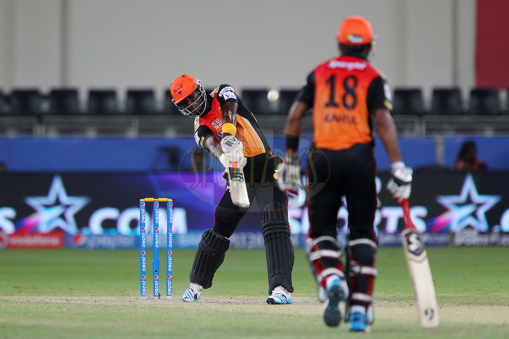 Darren Sammy of the Sunrisers Hyderabad launches a six on his first delivery during match 20 of the Pepsi Indian Premier League Season 2014 between the Mumbai Indians and the Sunrisers Hyderabad held at the Dubai International Stadium, Dubai, United Arab Emirates on the 30th April 2014<br /> <br /> Photo by Ron Gaunt / IPL / SPORTZPICS