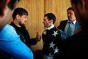 "Chechen President Ramzan Kadyrov gives a pep talk to the rider of his horse shortly before a race in Moscow's Hippodrome. .Kadyrov's horse, ""Royal Quiet"", came first in the 1600-metre race. .The horse, born in the U.S.A., is parented by father: Real Quiet, mother: Dinasoar, is trained by S. G. Kolesnikov and rode by master jockey S. V. Petin."