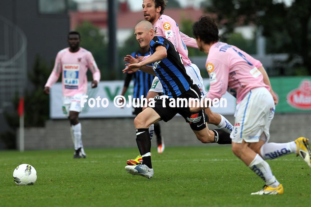 15.7.2012, Veritas stadion (Kupittaa), Turku..Veikkausliiga 2012..FC Inter Turku - JJK Jyv?skyl?..Joni Kauko (Inter) v Tamas Gruborovics (JJK)..