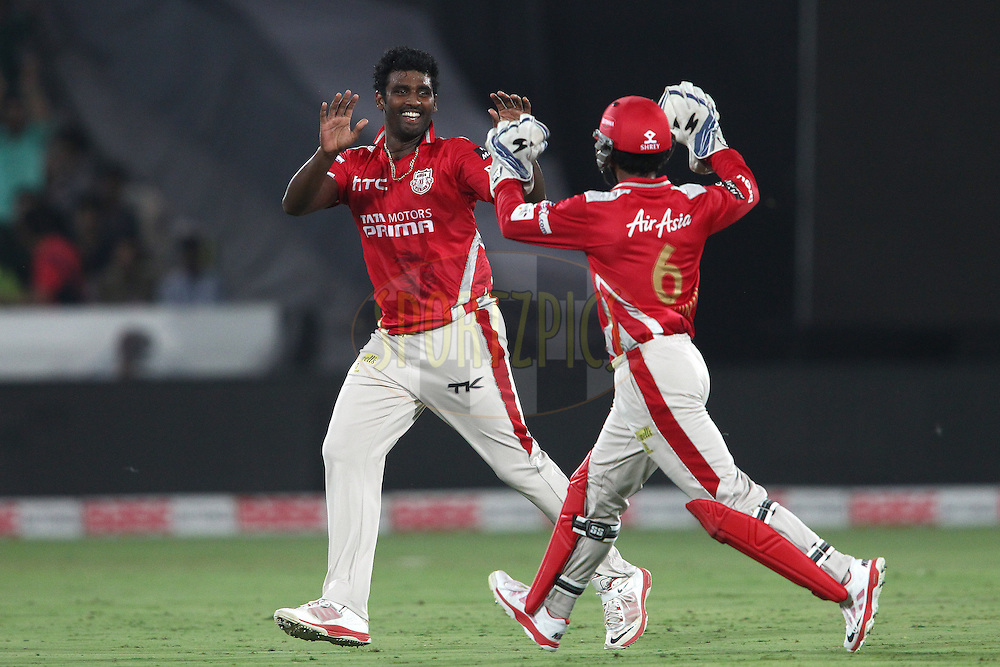 Thisara Perera of the Kings XI Punjab is congratulated by Wriddhiman Saha of the Kings XI Punjab for getting Brendon McCullum of the Chennai Super Kings wicket during the second semi final match of the Oppo Champions League Twenty20 between the Kings XI Punjab and the Chennai Superkings held at the Rajiv Gandhi Cricket Stadium, Hyderabad, India on the 2nd October 2014<br /> <br /> Photo by:  Shaun Roy / Sportzpics/ CLT20<br /> <br /> <br /> Image use is subject to the terms and conditions as laid out by the BCCI/ CLT20.  The terms and conditions can be downloaded here:<br /> <br /> http://sportzpics.photoshelter.com/gallery/CLT20-Image-Terms-and-Conditions-2014/G0000IfNJn535VPU/C0000QhhKadWcjYs