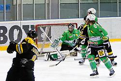 Klemen Sodrznik of HK Playboy Slavija scores a goal vs Pierre Svensson of EHC Bregenzerwald during 5th game of final INL league ice hockey match between HK Playboy Slavija and EHC Bregenwald at Dvorana Zalog, on April 3, 2013, in Ljubljana, Slovenia. (Photo by Matic Klansek Velej / Sportida)