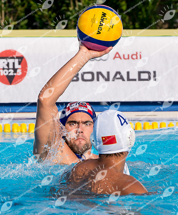 12 OBRADOVIC Paulo CRO 4 DONG Tao CHN<br /> China CHN (white) - Croatia CRO (blue)<br /> day 03 - 25/06/2015<br /> FINA Water Polo World League Superfinal Men<br /> Bergamo (ITA) 23-28 June 2015<br /> Photo G.Scala/Deepbluemedia