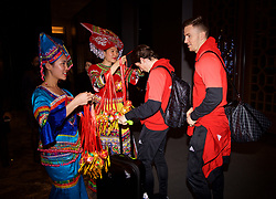 NANNING, CHINA - Monday, March 19, 2018: Wales' Harry Wilson and Lee Evans are greeted by women in traditional costume as the team arrive at the Wanda Realm Resort in Nanning for the 2018 Gree China Cup International Football Championship. (Pic by David Rawcliffe/Propaganda)