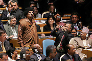 A delegate snaps a photo of Muammar al-Qadafi, Leader of the Socialist People's Libyan Arab Jamahiriya, entering the General Assembly Hall during the general debate of the Assembly's sixty-fourth session.