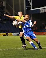Photo: Tony Oudot/Richard Lane Photography. Gillingham v Burton Albion. FA Cup 2nd Round. 28/11/2009. <br /> Shaun Harrad of Burton challenges Gillinghams Josh Gowling