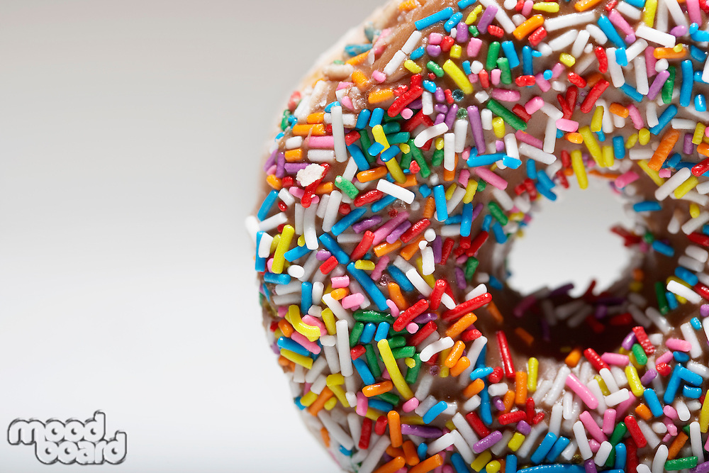 Rainbow sprinkles on doughnut