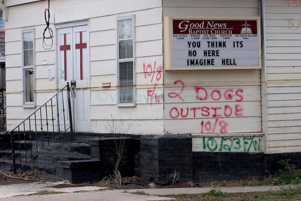 10 December, 05.  New Orleans, Louisiana. Post Katrina aftermath. <br />  Signs outside the Good News Baptist Church in Gentilly. <br /> Photo; ©Charlie Varley/varleypix.com